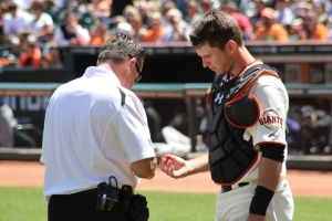 Buster Posey takes one for the team