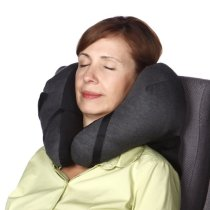 Sleeping woman wearing a travel neck pillow