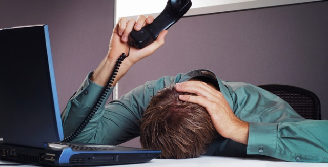 Man going into a coma waiting to get off hold with customer service.