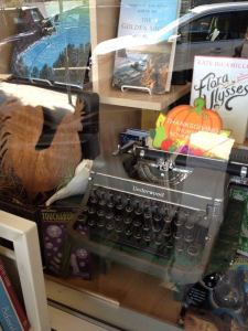 A manual typewriter in the window display of Coastal Books in Half Moon Bay, California