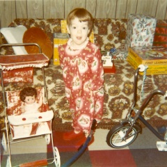 Photo of me, about age 4, on Christmas morning surrounded by gifts.
