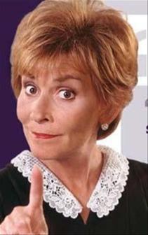 TV's Judge Judy wags her finger in a tsk tsk motio