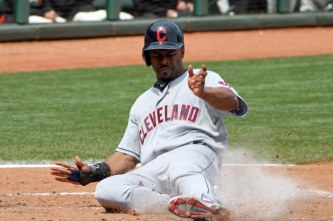Cleveland Indian Michael Bourn slides into home plate at AT&T Park. April 26, 2014.