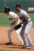 Cleveland first baseman Nick Swisher tries to hold San Francisco Giant Brandon Hicks on the bag. AT&T Park. April 26, 2014.