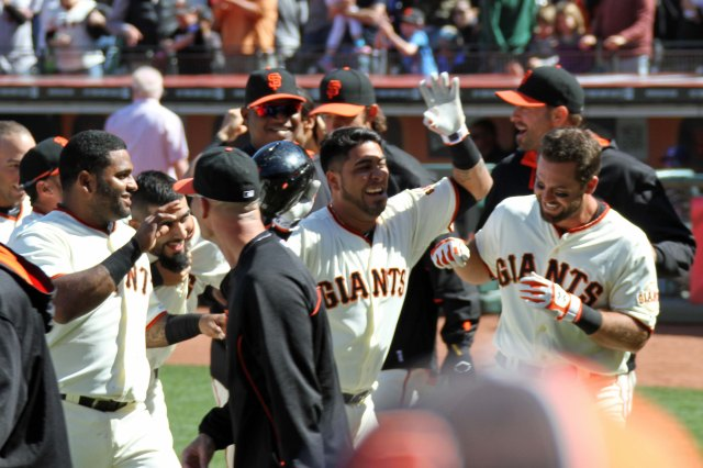 The San Francisco Giants celebrate Brandon Hicks' 3-run walk off home run against the Cleveland Indians. AT&T Park. April 27, 2014.