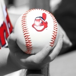 Boy holds Cleveland Indians baseball with Chief Wahoo logo. Cactus League, Scottsdale Arizona. March 16, 2014