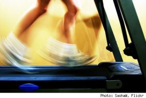 Feet running on a treadmill