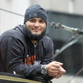 San Francisco Giants reliever Yusmeiro Petit rides in the World Series victory parade on October 31, 2014.
