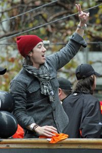 San Francisco Giants pitcher Tim Lincecum rides in the World Series victory parade on October 31, 2014.