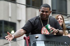 San Francisco Giants third baseman Pablo Sandoval rides in the World Series victory parade on October 31, 2014.